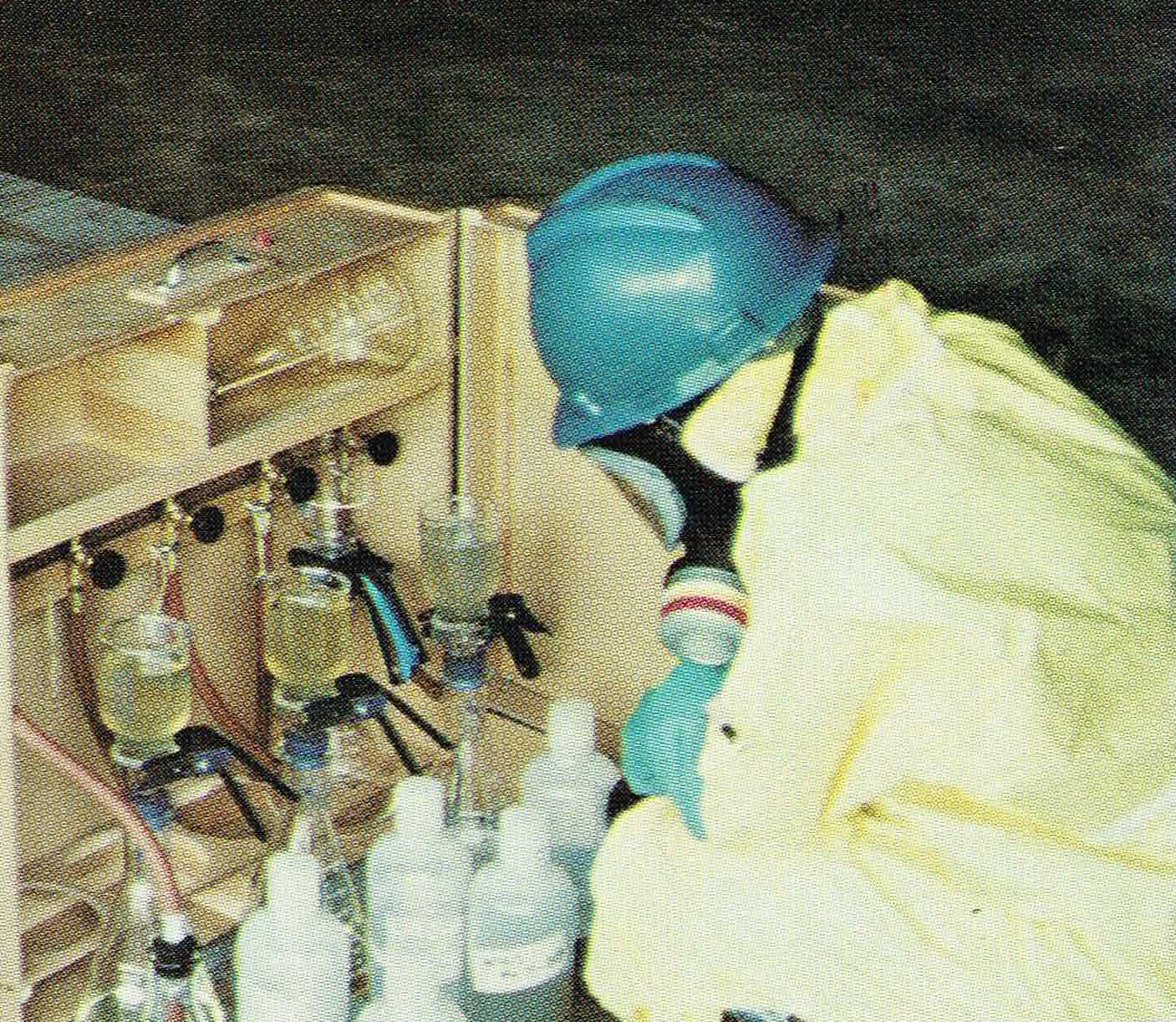 Deb in Level C gear filtering groundwater samples on a field job.